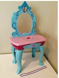 pink and blue wooden chair
