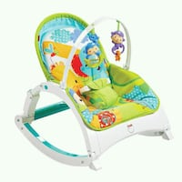 baby's multicolored Fisher-Price bouncer 535 km