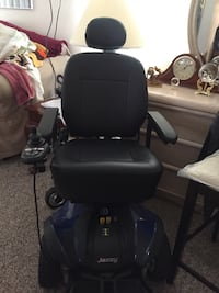 Black and blue Jazzy motorized wheelchair