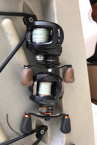 2 fishing reels and 2 rods