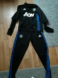 Survetement Manchester United taille S neuf