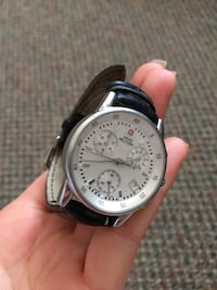 Round silver Swiss Military chronograph watch with black leather strap