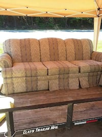 brown and beige striped padded sofa
