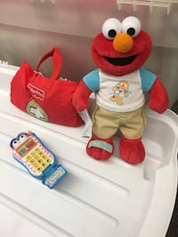 Cute Elmo the Doctor set with Doctor bag and Doctor equipment included inside bag.  Bonus offer, Elmo's talking cell phone included in price.   Toronto, M1S 0C7