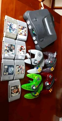 Nitendo 64 w/ 2 90s era controllers, 2 new era controllers and 7 games