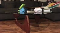 glass-top center table with brown wooden base Toronto, M6E 3W6