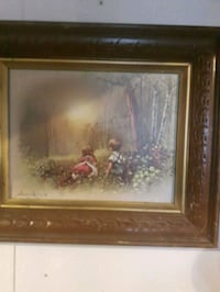 brown wooden framed painting of brown house London, N6E 2K4