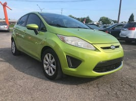 2011 GREEN FORD FIESTA SE Gᗩᔕ ᔕᗩᐯEᖇ  4 DOOR HEATED SEATS GAS SAVER 4 DOOR STICK SHIFT MOONROOF HEATED SEATS 1 OWNER SMOOTH