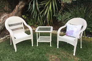 Wicker chairs, table and pillow