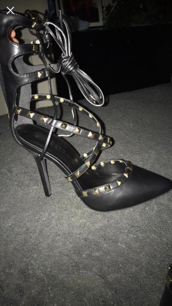 pair of black leather ankle strap heeled sandals