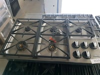 black and gray 4-burner gas stove Toronto, M9L 1S7