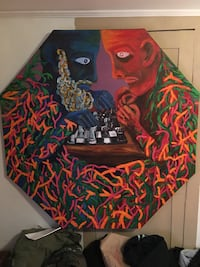 multi-colored painting of two person playing chess