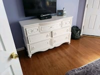 black flat screen TV with white wooden sideboard New York, 10019