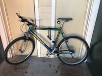 Blue and green mountain bike 2347 mi