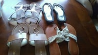 two pairs of black and white sandals Midland City, 36350