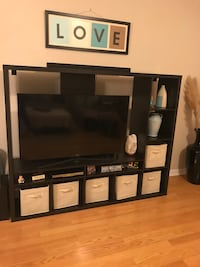 black wooden TV hutch with flat screen television Orlando, 32835