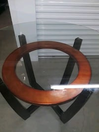 round brown wooden framed glass top coffee table Boston, 02124