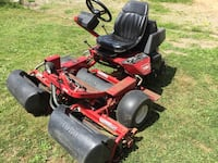 red and black zero-turn lawn mower Langley, V3A 2C5