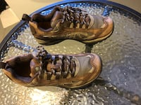 Pair of brown-and-black running shoes size 9 Winnipeg, R2K 4A1