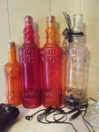 three red and clear glass bottle decors Lafayette, 70501