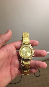 round gold-colored chronograph watch with link bracelet Central Okanagan, V4T 1X5