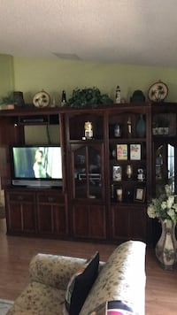 brown wooden TV hutch with flat screen television Leesburg, 34748