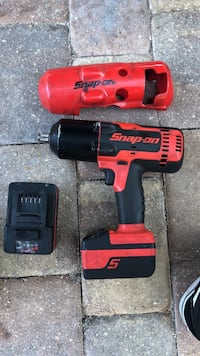 """Snap on 1/2"""" impact gun, lightly used comes with 2 batteries, cover, and snap on bag. Battery plastics haven't even came off yet Bonita Springs, 34135"""