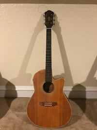 brown and black classical guitar Houston, 77020