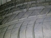 black car tire with tire Laval, H7T 1T1