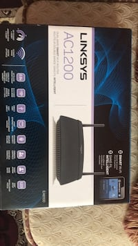 black and gray Linksys wireless router box Surrey, V4P 3L9
