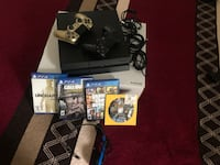 PS4 WITH HEAD SET FOUR GAMES AND TWO CONTROLLERS Lincoln Park, 48146