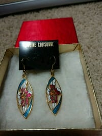 New earring. Metal. Gold colored earring