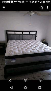 Eastern king size mattress with two black and silver nightstands. Henderson