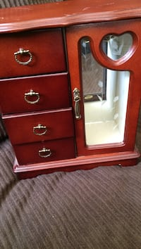 Brown wooden jewelry armoire Hedgesville, 25427