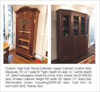 two brown wooden display cabinets