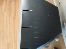 black wooden television stand