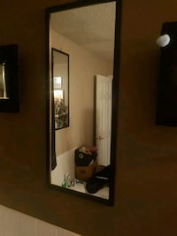 Tall black framed mirror.  Calgary, T2Y 4A6