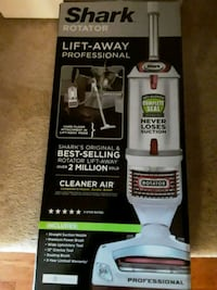 white and black Shark upright vacuum cleaner Greenbelt