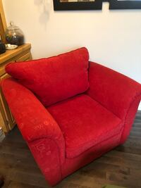 red fabric sofa chair with throw pillow Calgary, T2X 2S2