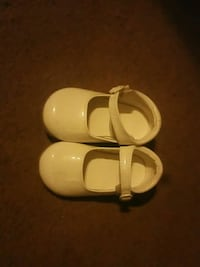 pair of white leather mary jane shoes