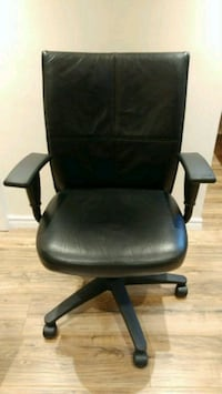 Fully adjustable black leather office chair