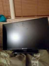 black flat screen TV with remote Silver Spring, 20906