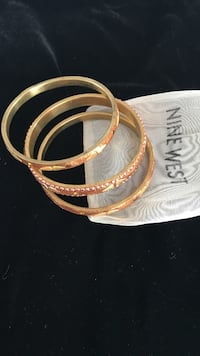 three gold-colored Nine West bangles Chambly