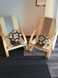 White, and gray armchairs with pillows