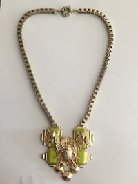 gold-colored Beetle pendant necklace