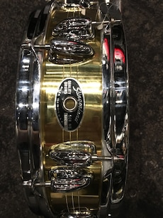 golden and silver snare drum