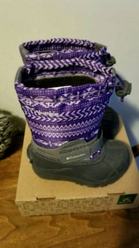 pair of purple-and-black duck boots 543 km