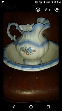 white and blue floral wash pitcher with basin