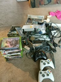 black Xbox 360 console with controllers and game cases Diamond, 44412