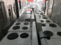 white and black electric coil range oven Montreal, H2G 2X3